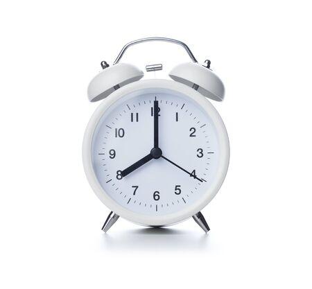 Retro alarm clock on isolated white background Stok Fotoğraf - 128816009