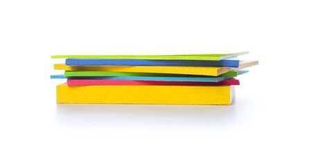 A stack of sticky notes in different colors