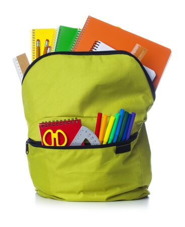 Green school backpack with school supplies isolated on white background Banco de Imagens
