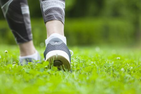 Young woman running outdoors in morning