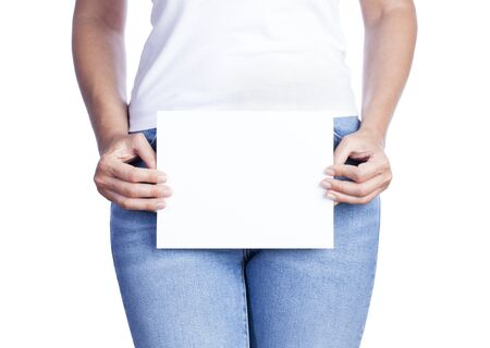 Young woman holding empty paper card for message on her waist