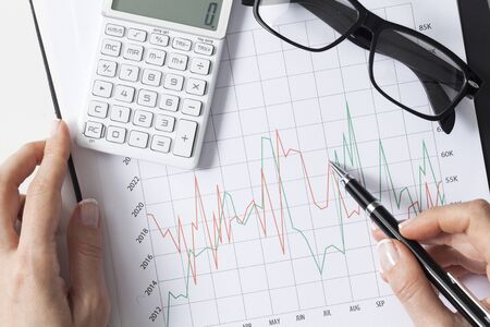 Close up businesswoman examining the situation on the market. Business financial concept. Data analysis. Developing business growth strategy