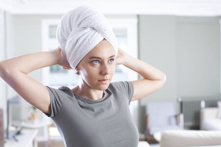 Close up of beautiful young woman with bath towel on head