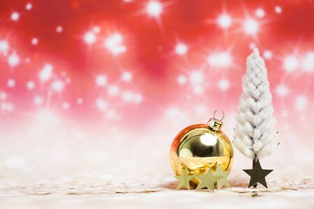 Christmas decoration objects on defocused red background Standard-Bild - 135007753