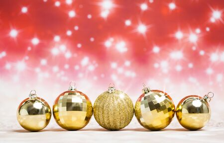Christmas balls decoration against red colored shiny background Standard-Bild - 135007764