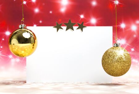 Greeting card for christmas with golden balls on shiny red background Standard-Bild - 135007768
