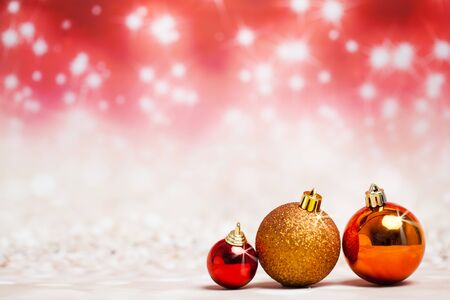 Christmas balls decoration against red colored shiny background Standard-Bild - 135007856