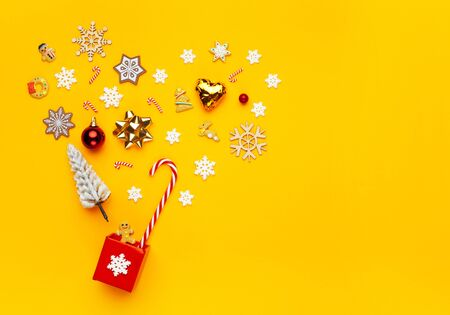 Christmas collection with gift box, snowflakes, candy cane on yellow background. Flat lay. Top view. Standard-Bild - 135007859
