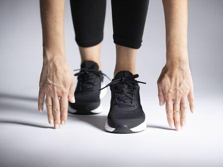 Woman preparing for track run race start
