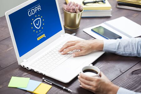 "General Data Protection Regulation. Laptop pc displaying ""GDPR"" on EU flag"