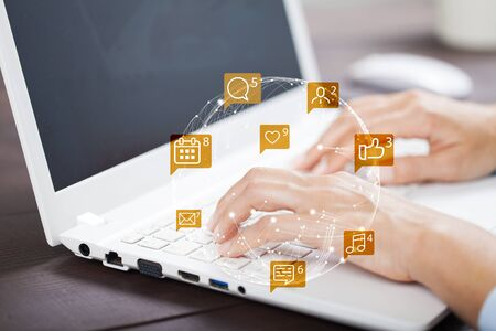 Woman hands using laptop with icon social media and social network.