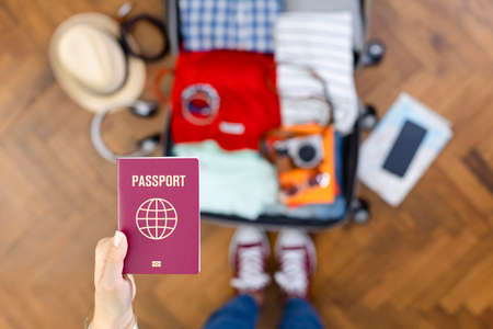 Young woman preparing for travel abroad