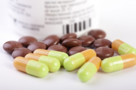 Pills and capsules with a bottle