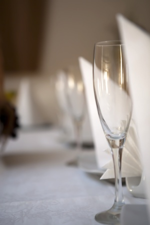 glases: A beautiful shot of glases on a tableinside a restaurant Stock Photo