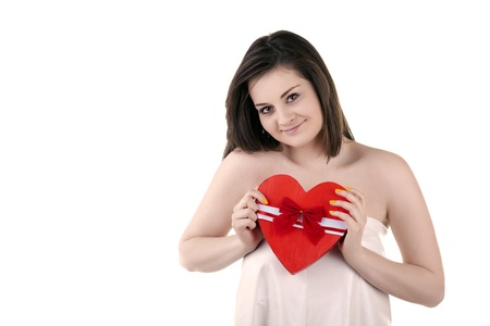Beautiful girl with a heart in her hands isolated on white studio shot Stock Photo