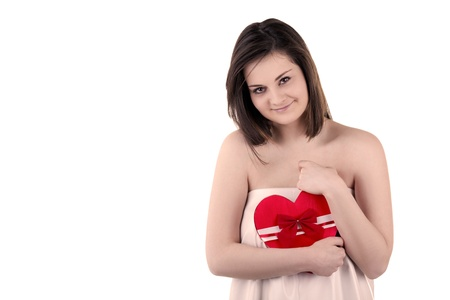 Gorgeous girl with a heart in her hands isolated on white background studio shot