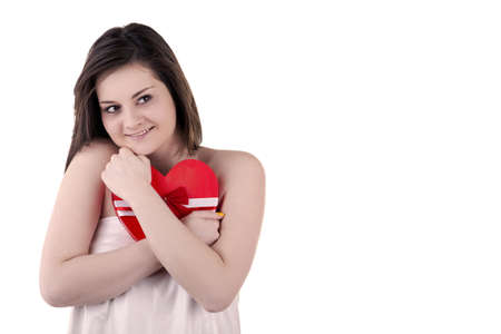 Beautiful girl with a heart shape in her hands isolated on white studio shot photo