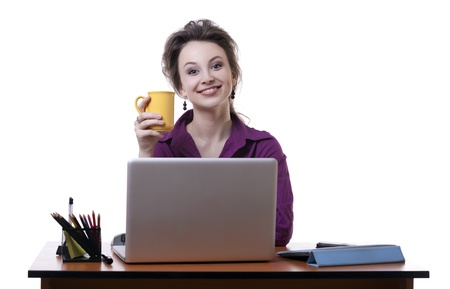 Young businesswoman at an office desk with a cup of coffe isolated on white studio shot photo