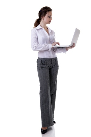 Businesswoman working at a laptop full length isolated on white background studio shot photo