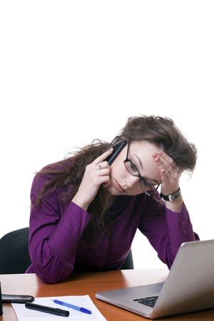 Stressed Businesswoman talking on the phone isolated on white studio shot Stock Photo