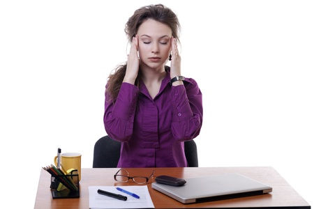 Beautiful busineewoman with a headache at an office desk isolated on white studio shot photo