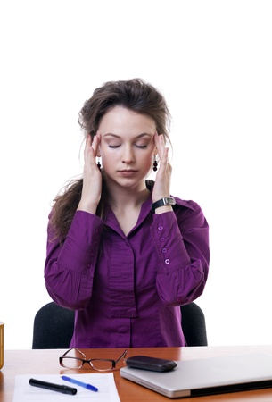 Businesswoman at an office table having a headache isolated on white background studio shot photo