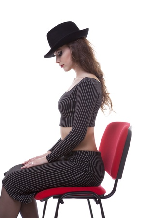 Woman sitting on a red chair isolated on white background studio shot photo