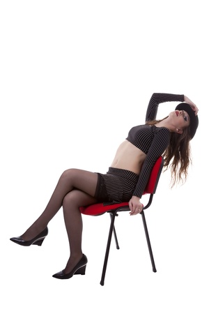 sexy girl sitting on a red chair isolated on white background studio shot photo
