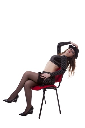 Sexy girl on a red chair full body isolated over white background studio shot photo