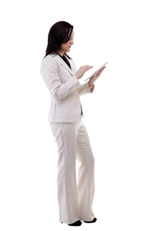 Caucasian secretary holding a tablet in her hands full body isolated on white background studio shot