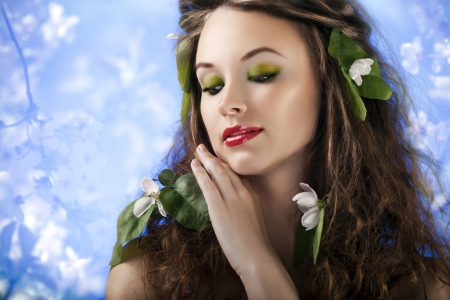 Sensual girl on abstract background from flowers