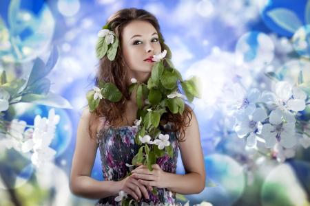 Gorgeous girl on abstrack flowers background studio shot Stock Photo