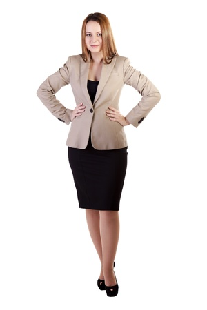 Businesswoman with hands on her hips isolated on white studio shot photo