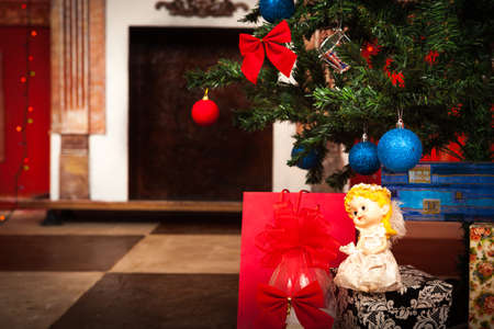 Christmas angel with a fireplace on background studio shot photo