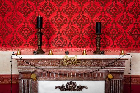Two candles on a fire place christmas vintage room on a red background Sensasional vintage Christmas interior studio shot Stock Photo - 21773808