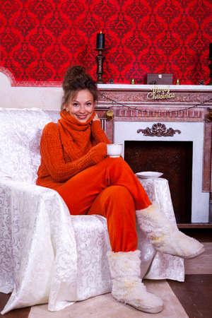 Beautiful girl inside a red vintage room with christmas decor studio shooting Stock Photo - 22619555