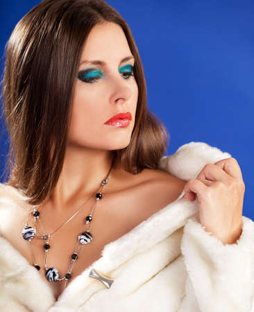Sensual woman in fur. Cosmetic and skincare. Fashion glamour style photography. Toned skin. Expensive luxury jewellery