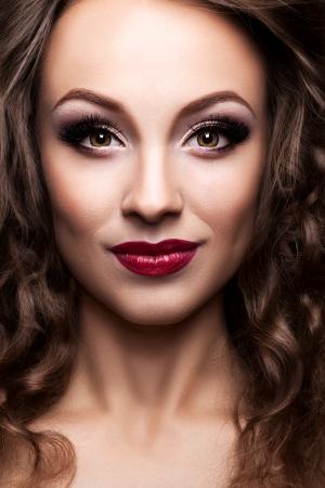 Gorgeous beautiful girl. Professional make-up. Toned skin. Glamour fashion type photography. Inside studio professional lighting Stock Photo