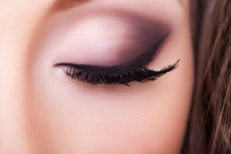 Macro shot of an eye professional make up. Studio shooting.