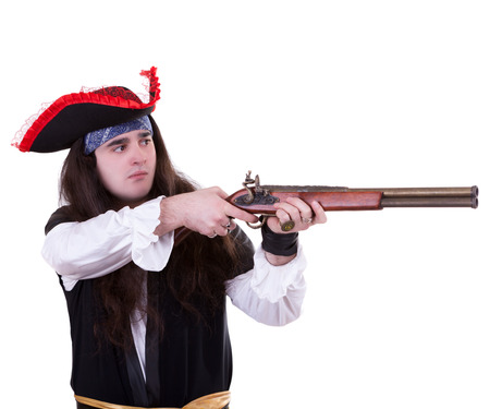 Pirate with a musket on white background studio shooting photo