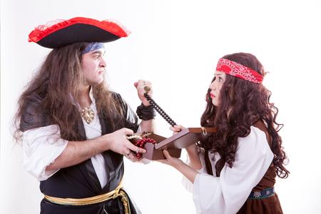 Two pirates fighting for box of tresure studio shooting photo