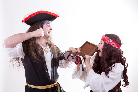 Two pirates fighting for box of tresure studio shooting photo