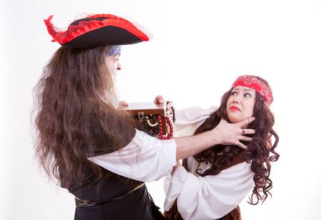 tresure: Two pirates fighting for box of tresure studio shooting