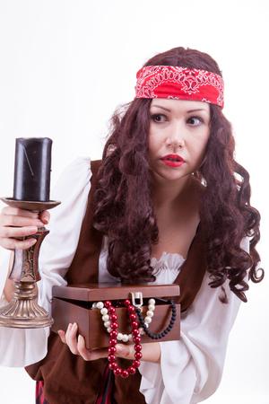 tresure: Pirate woman on white background studio shooting