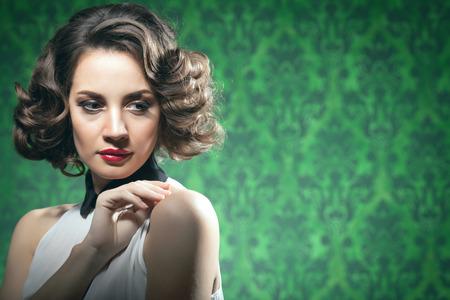 Sensual woman vintage interior retro style. Professional make up and studio shooting Stock Photo