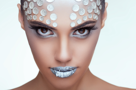 Woman with rhinestone make up studio shooting. Professional hairstyle and make up