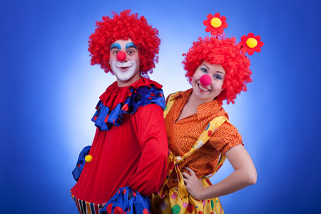 Clowns on blue background. Studio shooting with professional lighting Stock Photo