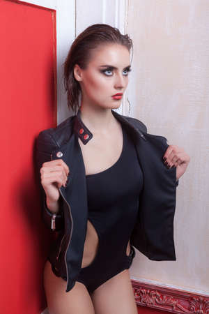 Gorgeous woman in leather jacket and swimsuit.  photo