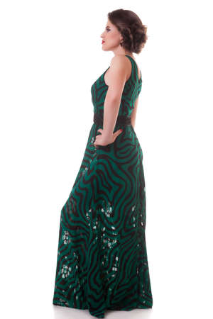 Woman in gorgeous green dres isolated on white background. Professional studio lighting. Full body photo
