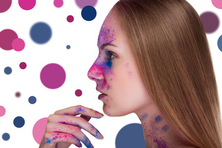 vibrant colours: Young woman fashion make up and dots on background. Studio professional lighting. Fashion vibrant colours